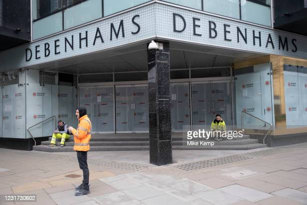 Very few people out along Oxford Street pass Debenhams, which is now completely closed down with the name of a demolision company in the windows as...