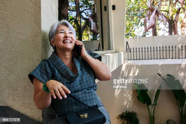 Very happy senior woman receiving great news on the phone