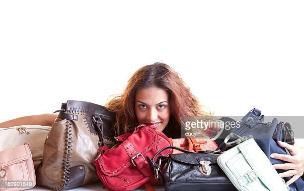 A very happy woman who is a shopaholic