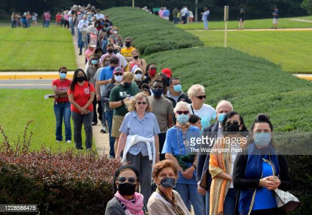Very long line of voters wait to cast their ballots at the Fairfax County Government Center for the November presidential election on first day of...