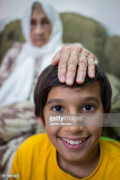 Very old Muslim woman at home