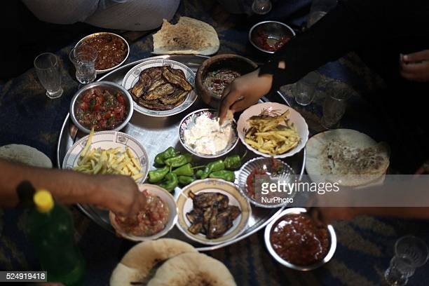 Very poor Palestinian family to eat breakfast because they break the fast during the Muslim fasting month of Ramadan in the Nuseirat refugee camp in...