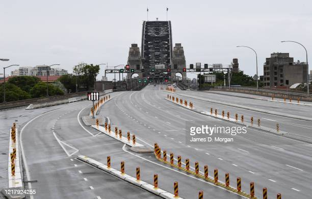 Very quiet roads with few cars out and about mid-morning approaching the Harbour Bridge on April 10, 2020 in Sydney, Australia. Australians have been...