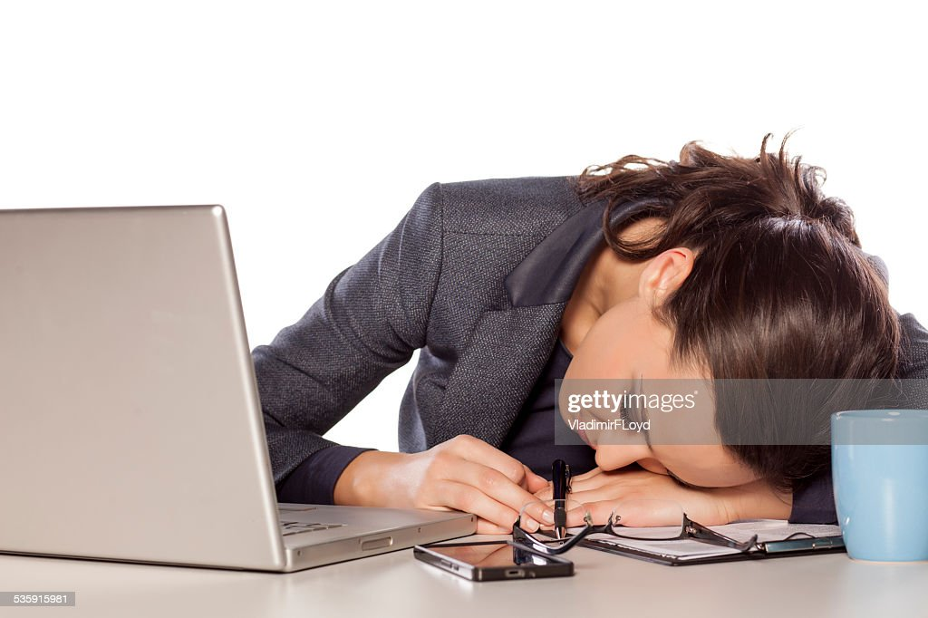 Very tired business woman asleep on a laptop : Stock Photo