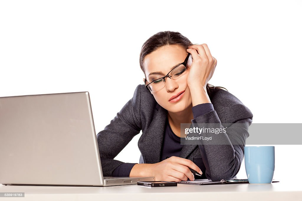 Very tired business woman fell asleep leaning on her hand : Stock Photo