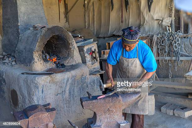 very traditional way to make kitchen knife in rural china - hot teacher stock pictures, royalty-free photos & images