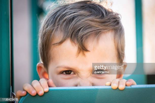 very upset three years old boy looking at the camera - 2 3 years stock pictures, royalty-free photos & images