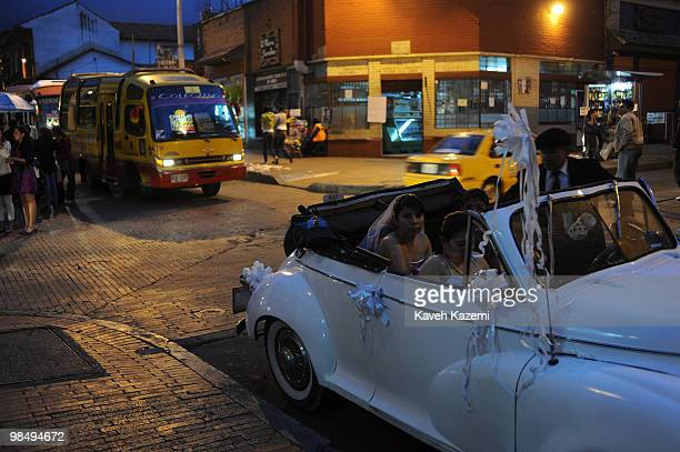 A very young bride sits with her family in a classic car in Candeleria old part of the city Bogota formerly called Santa Fe de Bogota is the capital...