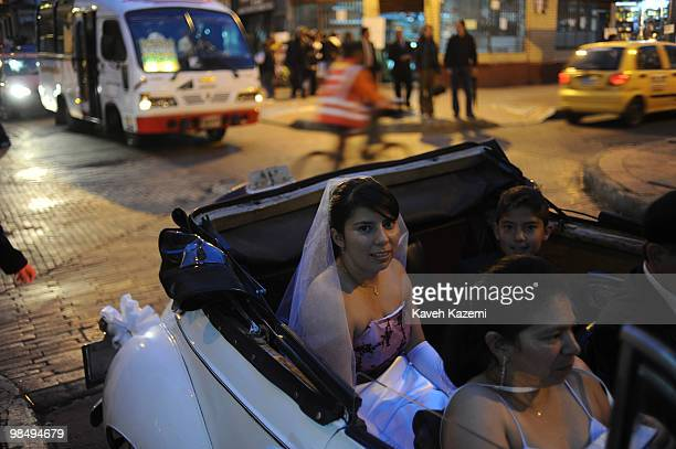 A very young bride sits with her family in a classic car in Candeleria the old part of the city Bogota formerly called Santa Fe de Bogota is the...
