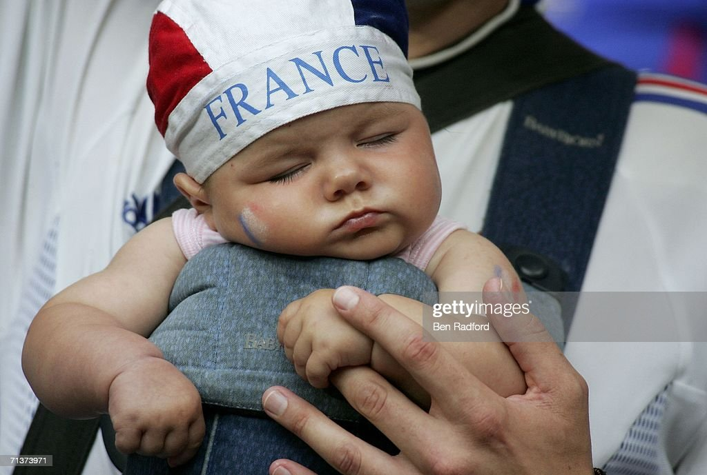 A very young French fan sleeps prior to kickoff during the ...