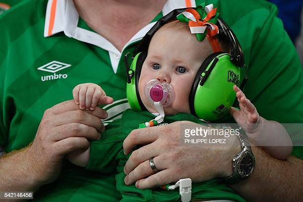 A very young Ireland supporter wears noise protecting headphones and a baby headband in the colors of Ireland prior to the Euro 2016 group E football...