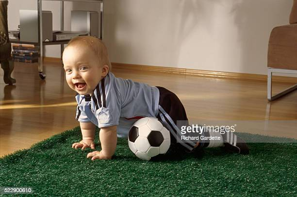 Very Young Soccer Player Trying to Walk