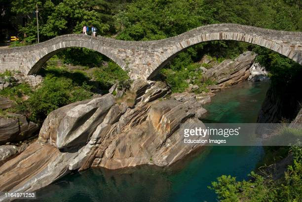 Verzasca river with the historic double arch stone bridge Ponte dei Salti Bridge of Leaps Roman Bridge near Lavertezzo in the Verzasca valley Ticino...
