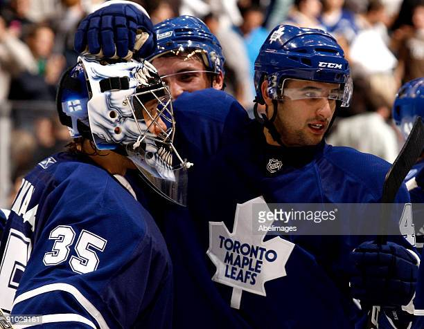 Vesa Toskala and Nazem Kadri of the Toronto Maple Leafs celebrate a win over the Pittsburgh Penguins in a preseason NHL game at the Air Canada Centre...