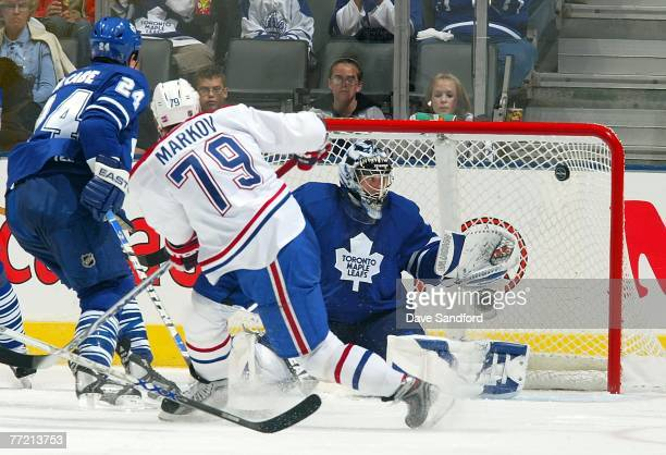 Vesa Toskala of the Toronto Maple Leafs is beat on this shot by Andrei Markov of the Montreal Canadiens during their NHL game at the Air Canada...
