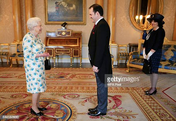Vesna Banovic looks on as her husband Borislav Banovic the Ambassador from Montenegro present his Letters of Credence to Queen Elizabeth II during a...