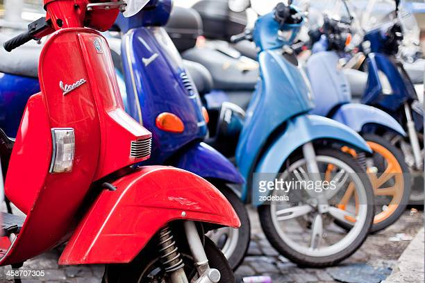 vespa and others scooters parked in rome, italy - moped stock photos and pictures