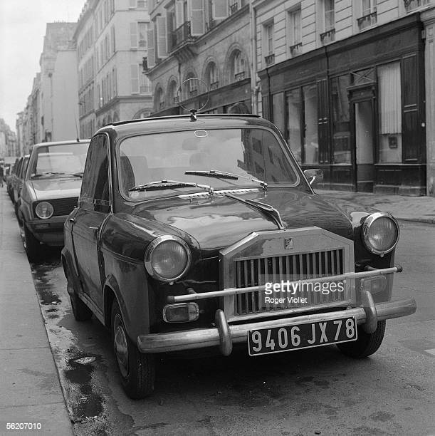 Vespa car provided with a grill imitating that of Rolls-Royce. Paris, 1979.