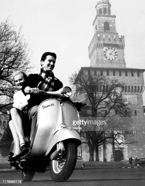 Vespa. Castello sforzesco. Milan. Italy. 1958.