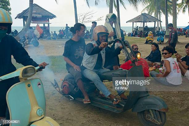 Vespa owners head home on their extremely modified vespas after a scooter festival on June 30 2013 in Cibeureum about 100 km west of Jakarta...