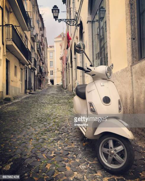 vespa parked on old lisbon street, portugal - vespa brand name stock pictures, royalty-free photos & images