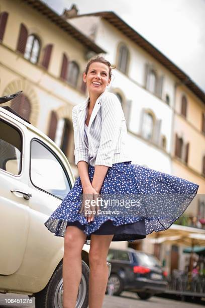 vespa - skirt blowing stock photos and pictures