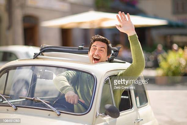 vespa - waving gesture stock photos and pictures