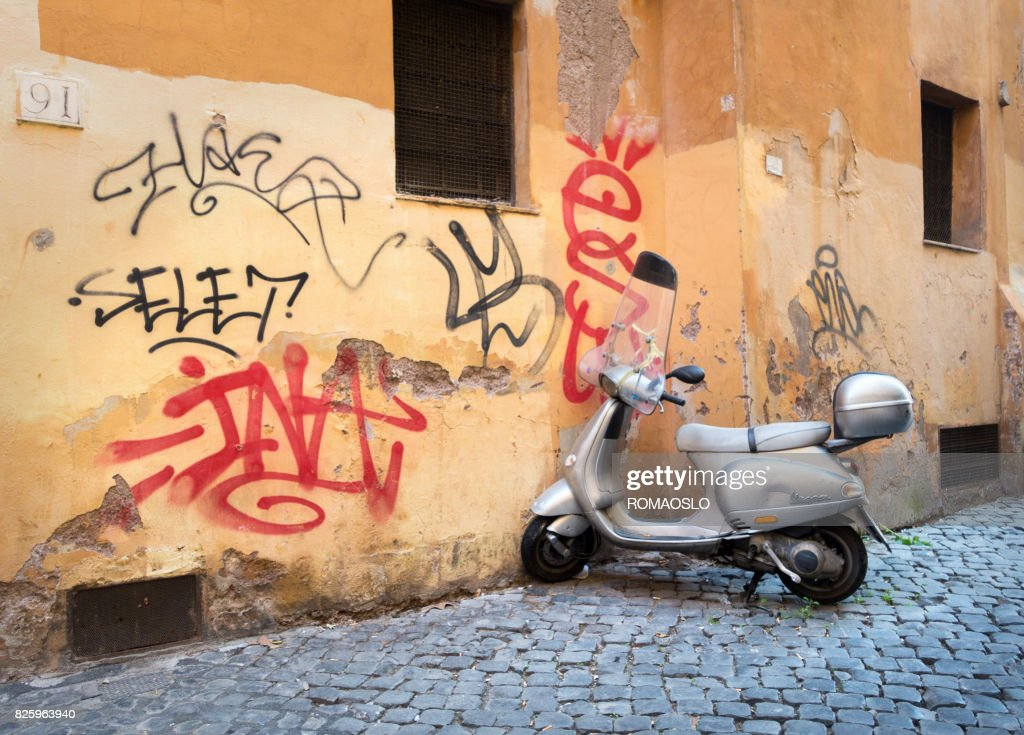 Vespa scooter and graffiti in an alley in Trastevere, Rome Italy : Stock Photo