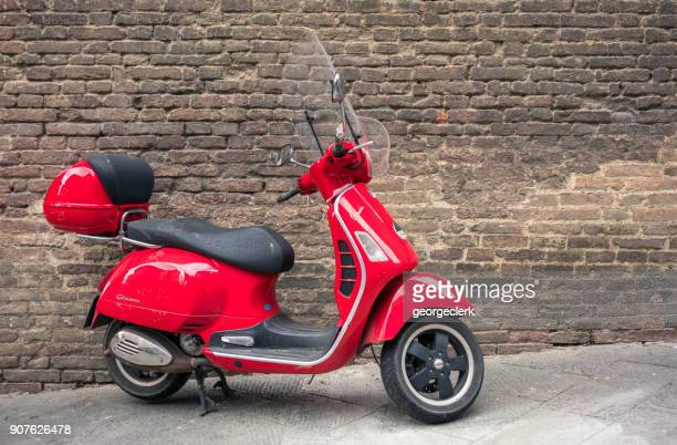 vespa scooter in siena, italy - moped stock photos and pictures