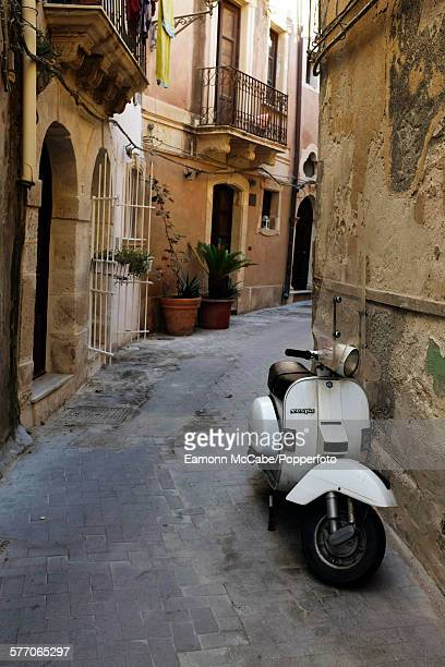 A Vespa scooter parked in the back streets of Syracuse Sicily Italy 25th January 2014