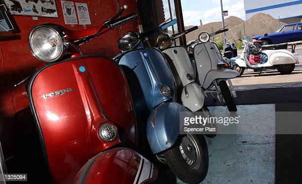 Vespa scooters are parked in a row July 11, 2001 at Bella Classica, a scooter garage and store in Brooklyn, New York City. Scooter riding, especially...