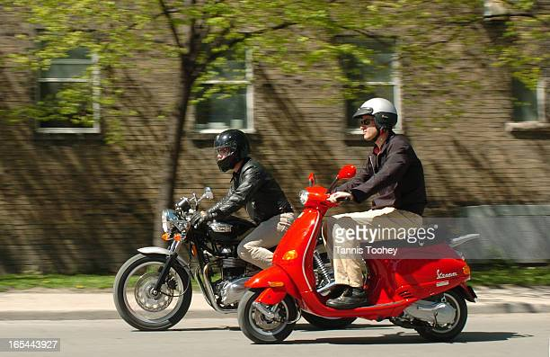May 11 2004Jeremy rides a VESPA ET2 scooter alongside Mark Richardson on his Triumph Thruxton in Toronto May 11 2004 The two machines are the...