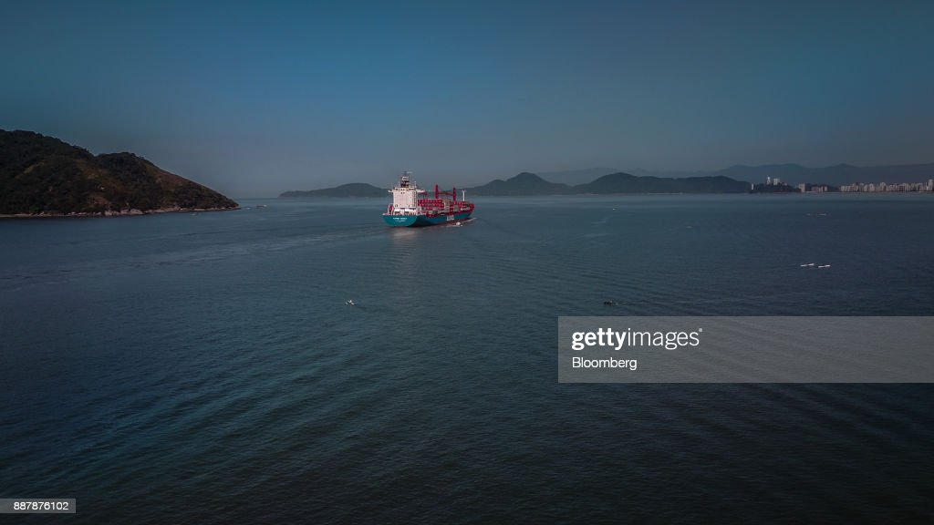 A vessel carrying shipping containers leaves from the Port of Santos in Santos, Brazil, on Thursday, Oct. 5, 2017. The port complex is a 3-square-mile microcosm of a country buffeted by political turmoil, drug-fueled violence and persistent income inequality as it emerges from a grinding recession. Photographer: Dado Galdieri/Bloomberg via Getty Images