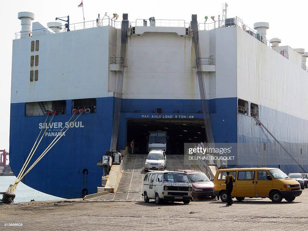 A Vessel Discharges Used Cars At The Autonomous Port Of Cotonou