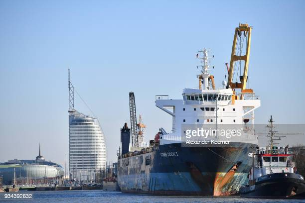 A vessel lies in the port on March 19 2018 in Bremerhaven Germany The new German government is seeking to prevent new tariffs between the European...