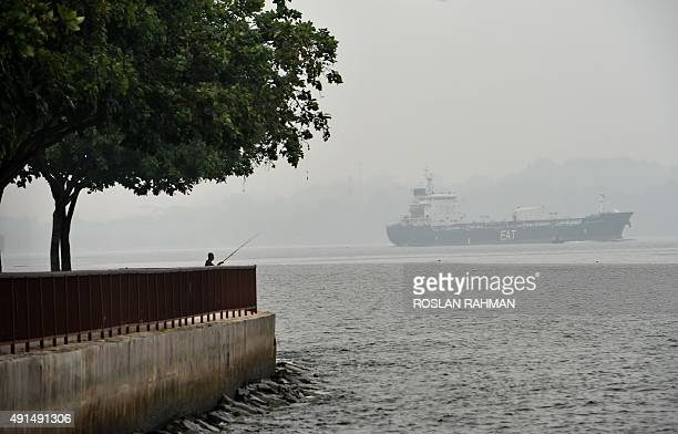 A vessel sails along the hazy Singapore strait on October 6 2015 Malaysia Singapore and large expanses of Indonesia have suffered for weeks from...