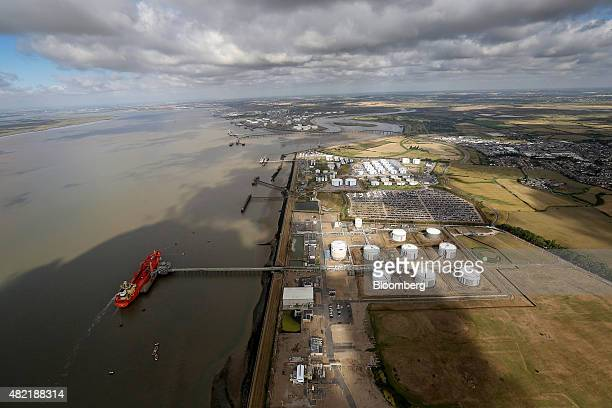 A vessel sits moored at a jetty alongside liquid gas storage tanks on the Calor Gas Ltd terminal in this aerial photograph taken near Canvey Island...