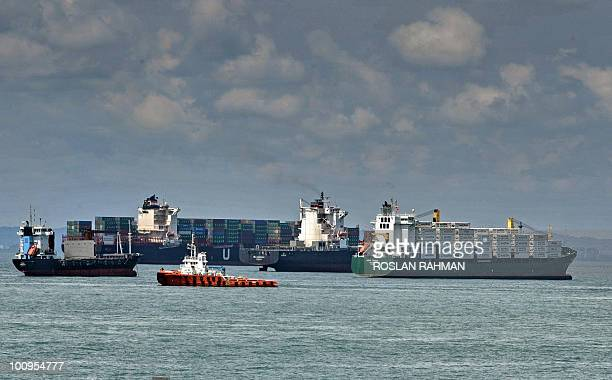 Vessels are seen plying the straits along Singapore waters on May 26 2010 An oil spill from a tanker damaged in a collision off eastern Singapore has...