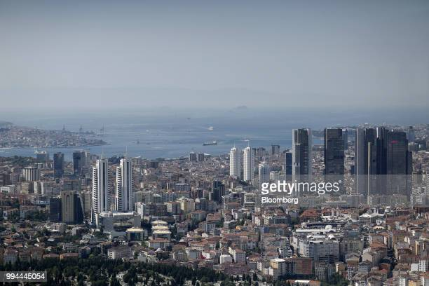 Vessels enter the Bosporus straits beyond highrise towers and residential buildings seen from the Saphire Tower in the district of Levent Istanbul...