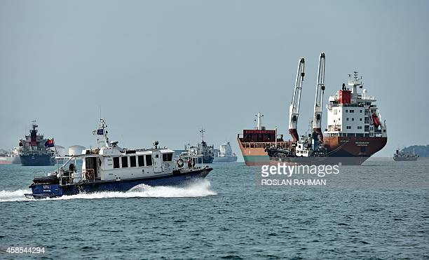 Vessels power along the straits of Singapore on November 7 2014 A Danish supplier of ship fuel OW Bunker said on November 6 it risked bankruptcy...