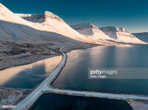 Vestfjardavegur road by the village of Flateyri, West Fjords, Iceland