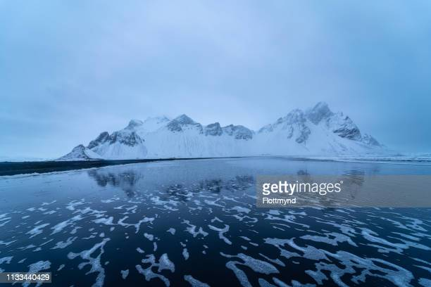 vestrahorn in a winterstorm, iceland - winter_storm stock pictures, royalty-free photos & images