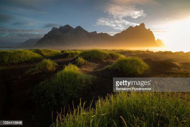 vestrahorn mountain in sunrise scence - east stock pictures, royalty-free photos & images