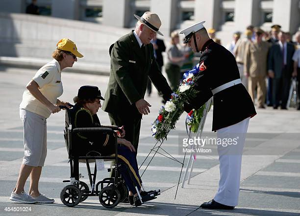 WWII veteran 106 year old Ret Lt Col Luta Mae Cornelius McGrath sits in a wheel chair as she lays a wreath during ceremony at the World War II...
