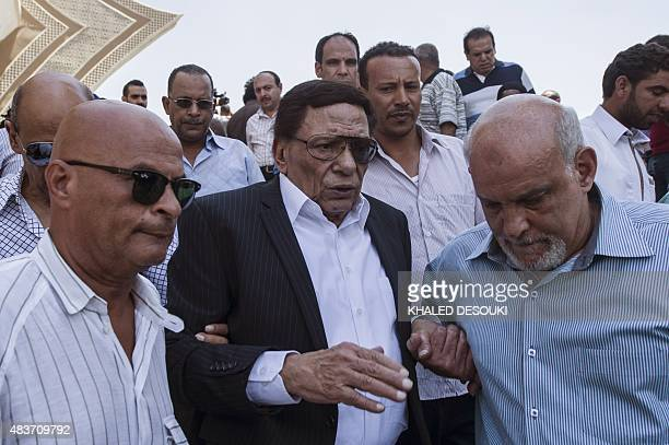 Veteran actor Adel Imam leaves after attending the funeral of Egyptian film star Nur alSharif on August 12 at a mosque in Sheikh Zayed City on the...