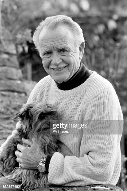 Veteran actor Sir John Mills in the gardenof his Queen Anne cottage in the Buckinghamshire village of Denham in Bucks with his pet dog