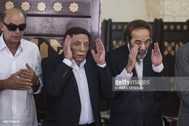 Veteran actors Adel Imam and Mahmud Yassin pray during the furneral of Egyptian film star Nur alSharif on August 12 at a mosque in Sheikh Zayed City...