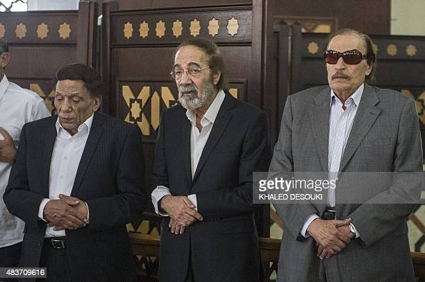 Veteran actors Adel Imam Mahmud Yassin and Ezzat alAlaily pray during the furneral of Egyptian film star Nur alSharif on August 12 at a mosque in...