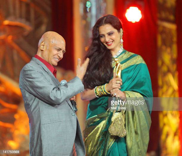 Veteran actress Rekha honouring veteran music director Khayyam at the Radio Mirchi Music Awards 2012 held at Bhavans College in Mumbai on March 21...