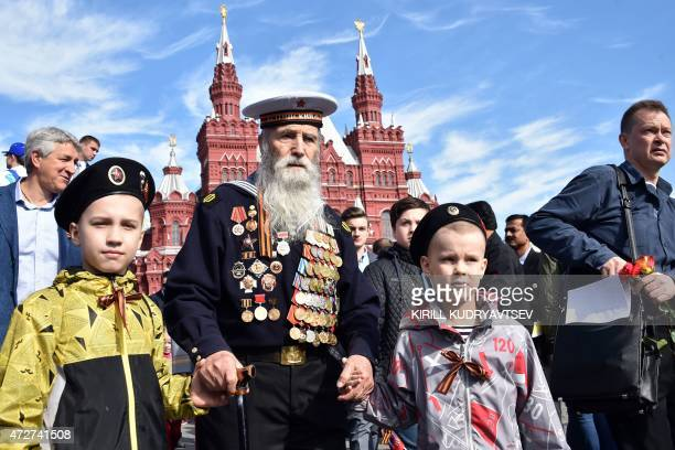 A WWII veteran arrives at Moscow's Red Square on May 9 to watch the Victory Day military parade Russian President Vladimir Putin presides over a huge...